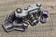 Old camera and films Stock Photos