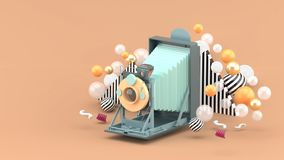 Old camera floating among colorful balls on brown background vector illustration