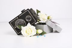 Old camera and flowers and box royalty free stock photography