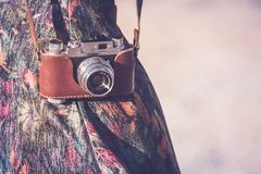 Old camera. Girl wearing an old camera on the strap Stock Images