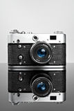 Old camera on the glass Royalty Free Stock Photo