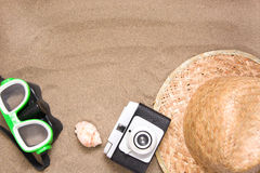Old camera goggles  snorkel and shell tube on sand Royalty Free Stock Photography