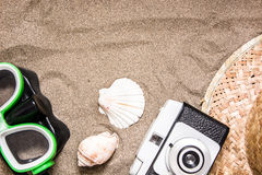 Old camera goggles  snorkel and shell tube on sand Royalty Free Stock Image