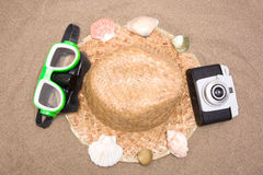 Old camera goggles  snorkel and shell tube on sand Stock Image