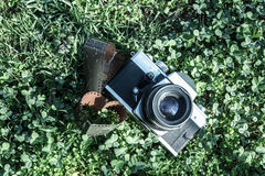 Old camera on grass Royalty Free Stock Image