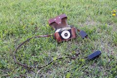 Old camera on the green grass in the garden. Old camera on the green grass on the garden stock image