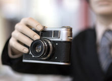 Old camera in the hands. Royalty Free Stock Photography