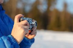 Old camera in hands, photography concept royalty free stock photography