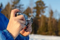 Old camera in hands, photography concept stock images