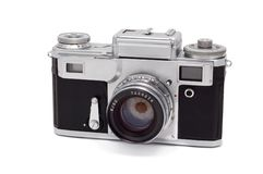 Old camera isolated on a white. Royalty Free Stock Images
