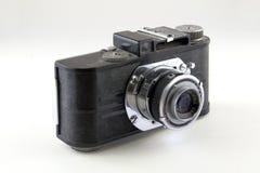 Old camera isolated on white. Vintage black chrome camera isolated on white stock photography