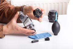 Old camera and lens in male hand Stock Photography