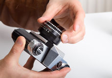 Old camera and lens in male hands Royalty Free Stock Photos
