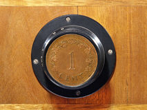 Old camera lens with one cent coin inside. Stock Image