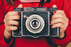 Old camera in little girl hands Stock Photo