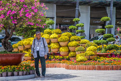 An old Camera man ( camera-man ) is standing in the garden in the center of Saigon , Vietnam to provide photo service for people w Royalty Free Stock Photography