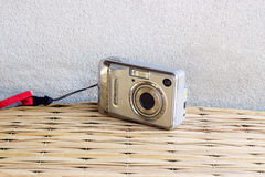Old camera on mat weave and concrete background Royalty Free Stock Photography