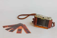 Old camera with negative Stock Images