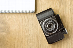 Old camera and notepad Royalty Free Stock Image