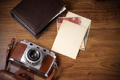 Old camera and old pictures album Stock Images