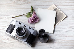 Old camera and old pictures album Royalty Free Stock Photography