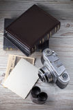 Old camera and old pictures album Royalty Free Stock Images