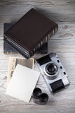 Old camera and old pictures album Stock Photo