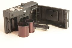 An old camera with open back with film Royalty Free Stock Images