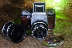 Old camera- `Pentacon SixTL`. Well served camera. The Pentacon Six is a single-lens reflex SLR medium format camera system made by Pentacon from 1956 to 1992 royalty free stock photo