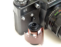 Old camera and photo film. On white background Royalty Free Stock Images