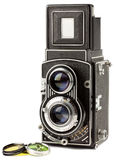 Old camera with photo-filter. White background Stock Photos