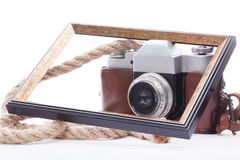Old camera and photo frame isolated on white background. Old camera and photo frame isolated on white royalty free stock photos