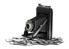 Old camera with photo frames Royalty Free Stock Photo