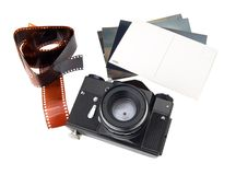 Old camera with photoes and negative Royalty Free Stock Image
