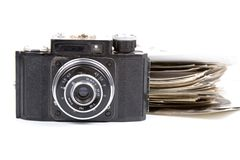 Old camera and pictures Stock Photography
