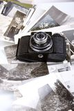 Old camera and pictures Royalty Free Stock Image