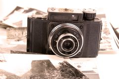 Old camera and pictures Royalty Free Stock Images