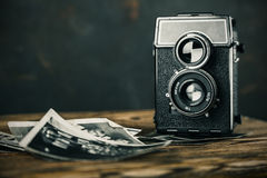 Old camera and  pictures Royalty Free Stock Photos