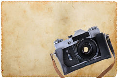 Old camera placed on an old paper Stock Photo