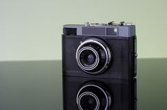 Old camera. With reflected background Royalty Free Stock Photo