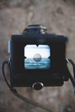 Old camera and the sea viewfinder Stock Photos