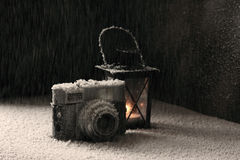 Old camera in the snowing. Old camera is  under the heavy snowing Royalty Free Stock Image