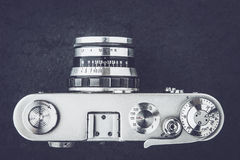 Old camera on the stone background black and white Stock Image