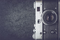 Old camera on the stone background black and white top view Royalty Free Stock Image