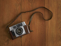 Old camera with strap Stock Photography