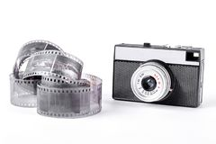 Old camera and tape on white background. Rangefinder vintage camera on white background Royalty Free Stock Image