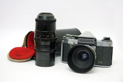 Old camera with telephoto lens Stock Image