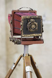 Old camera on a tripod Stock Images