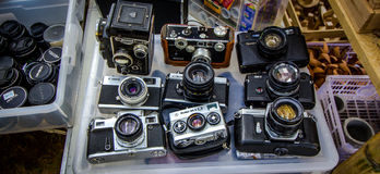Old camera. At two hand shop Royalty Free Stock Photo
