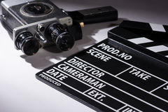Old camera with two lenses and a movie clapperboard Royalty Free Stock Photos